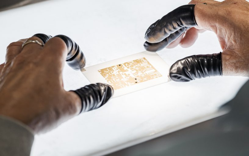 Circuit board with hands photography